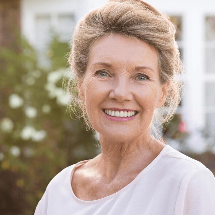 Woman wearing dentures.
