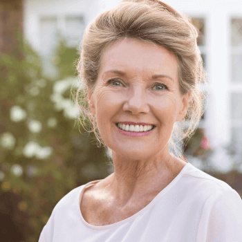 woman with dentures smiles - Peru, IL