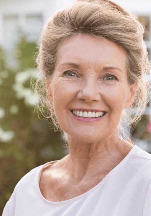 happy patient loves her new dentures in peru il